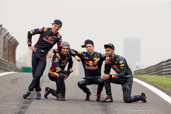 SHANGHAI, CHINA - APRIL 14:  Daniel Ricciardo of Australia and Red Bull Racing, Daniil Kvyat of Russia and Red Bull Racing, Carlos Sainz of Spain and Scuderia Toro Rosso and Max Verstappen of Netherlands and Scuderia Toro Rosso pose for a photo on the track during previews to the Formula One Grand Prix of China at Shanghai International Circuit on April 14, 2016 in Shanghai, China.  (Photo by Mark Thompson/Getty Images)