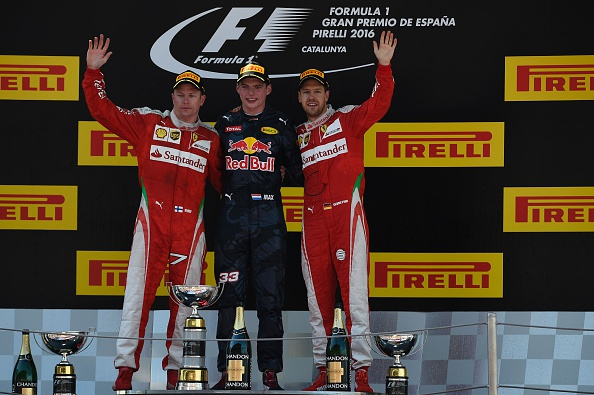 Ferrari's Finnish driver Kimi Raikkonen, Infiniti Red Bull's Belgian-Dutch driver Max Verstappen and Ferrari's German driver Sebastian Vettel celebrate on the podium after the Spanish Formula One Grand Prix on May 15, 2016 at the Circuit de Catalunya in Montmelo on the outskirts of Barcelona. / AFP / LLUIS GENE        (Photo credit should read LLUIS GENE/AFP/Getty Images)