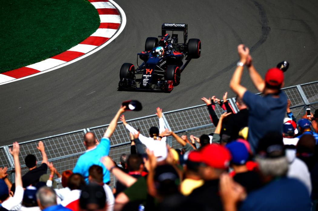 MONTREAL, QC - JUNE 10: Fernando Alonso of Spain driving the (14) McLaren Honda Formula 1 Team McLaren MP4-31 Honda RA616H Hybrid turbo waves at the crowd on track during practice for the Canadian Formula One Grand Prix at Circuit Gilles Villeneuve on June 9, 2016 in Montreal, Canada.  (Photo by Dan Istitene/Getty Images)