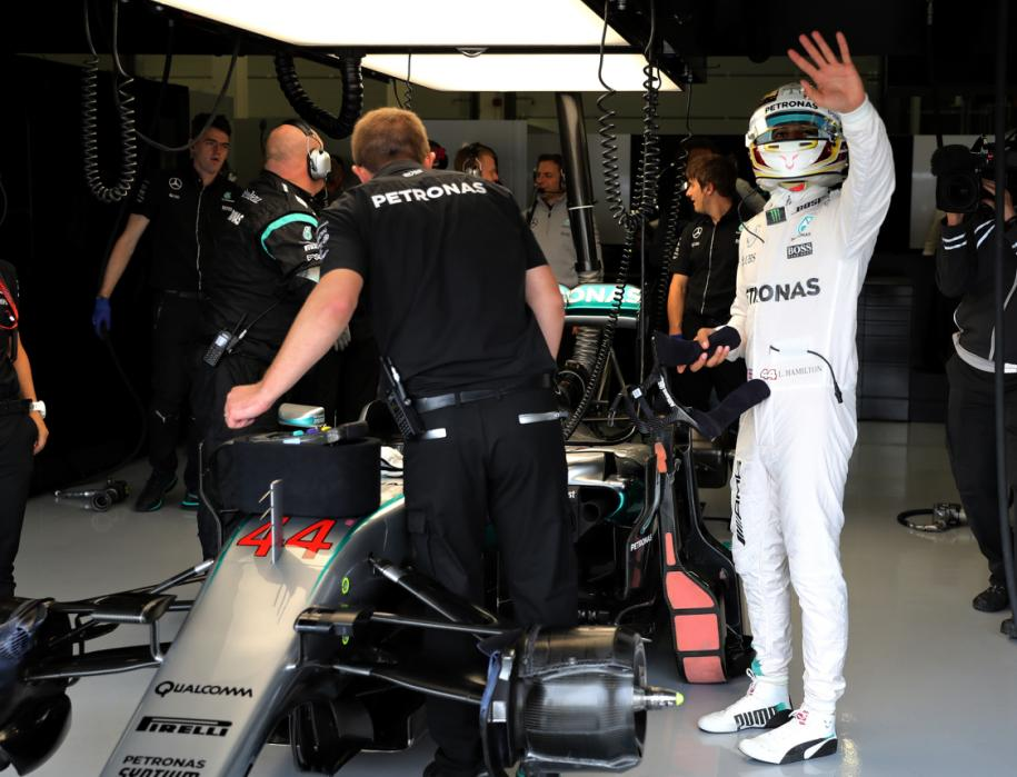 NORTHAMPTON, ENGLAND - JULY 09:  Lewis Hamilton of Great Britain and Mercedes GP waves to the crowd from his garage during qualifying for the Formula One Grand Prix of Great Britain at Silverstone on July 9, 2016 in Northampton, England.  (Photo by Mark Thompson/Getty Images)