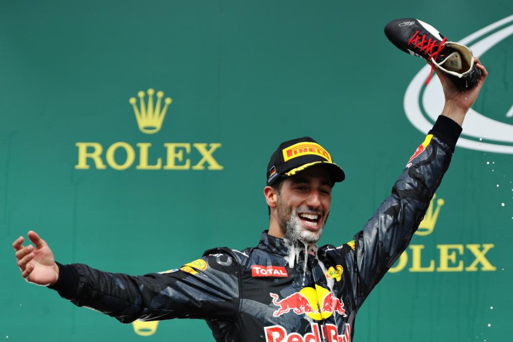 HOCKENHEIM, GERMANY - JULY 31: Daniel Ricciardo of Australia and Red Bull Racing celebrates 2nd place on the podium with his racing boot during the Formula One Grand Prix of Germany at Hockenheimring on July 31, 2016 in Hockenheim, Germany.  (Photo by Mark Thompson/Getty Images)