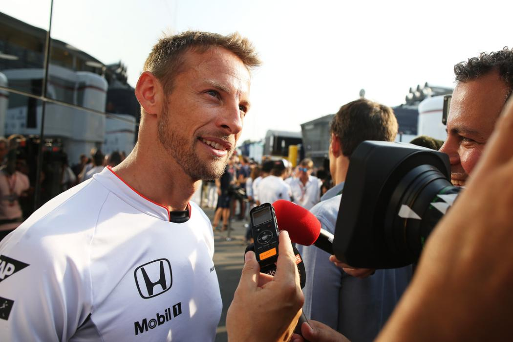 MONZA, ITALY - SEPTEMBER 03:  Jenson Button of Great Britain and McLaren Honda talks to the media after announcing that he will step back from a race seat in the 2017 season during qualifying for the Formula One Grand Prix of Italy at Autodromo di Monza on September 3, 2016 in Monza, Italy.  (Photo by Charles Coates/Getty Images)